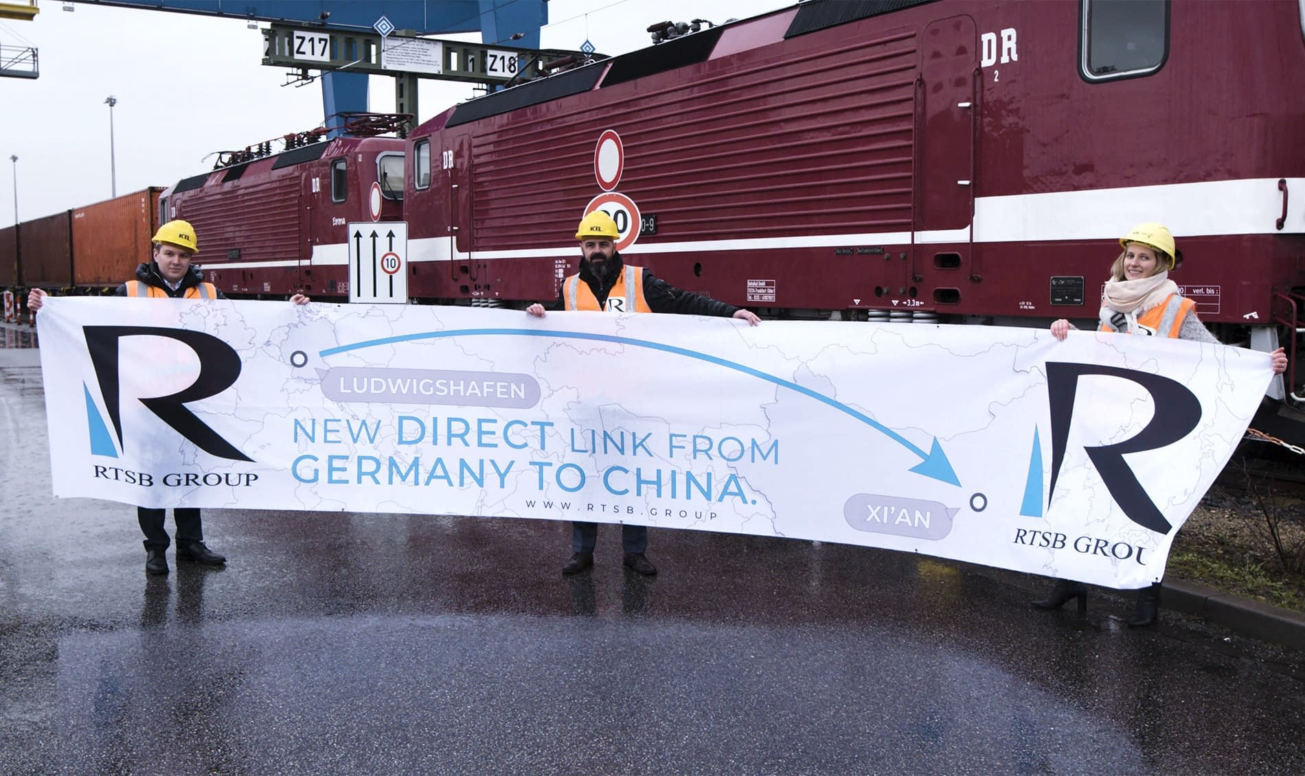 RTSB employees holding banner standing in front of container train in Ludwigshafen